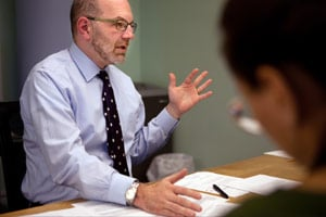 Craig Gurian, left, an attorney from The Anti-Discrimination Center who brought a fair housing lawsuit against Westchester County under the False Claims Act, works with colleague Heather Rogers, right, during a meeting in his office in New York, N.Y., on Oct. 23. (Melanie Burford for ProPublica)