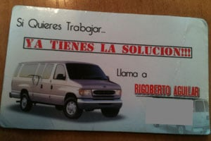 The business card of Rigo, whose full name is Rigoberto Aguilar, reads in Spanish, 'If you want to work, you have the solution.' Phone numbers have been obscured. (Michael Grabell/ProPublica)