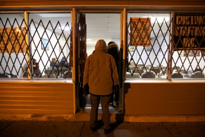 Temp workers line up at Custom Staffing near Chicago in the early morning hours of Jan. 18, 2013. (Sally Ryan for ProPublica)