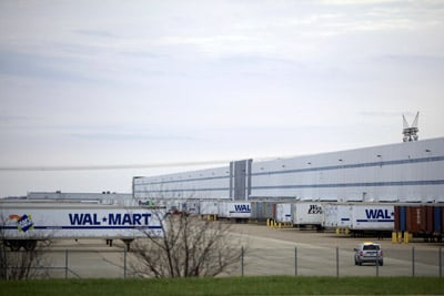 Walmart's warehouse complex southwest of Chicago is managed by Schneider Logistics. Walmart, along with many other American companies, benefits from temp labor, both for its flexibility and for the protection it provides from complaints from workers and regulators. (Sally Ryan for ProPublica)