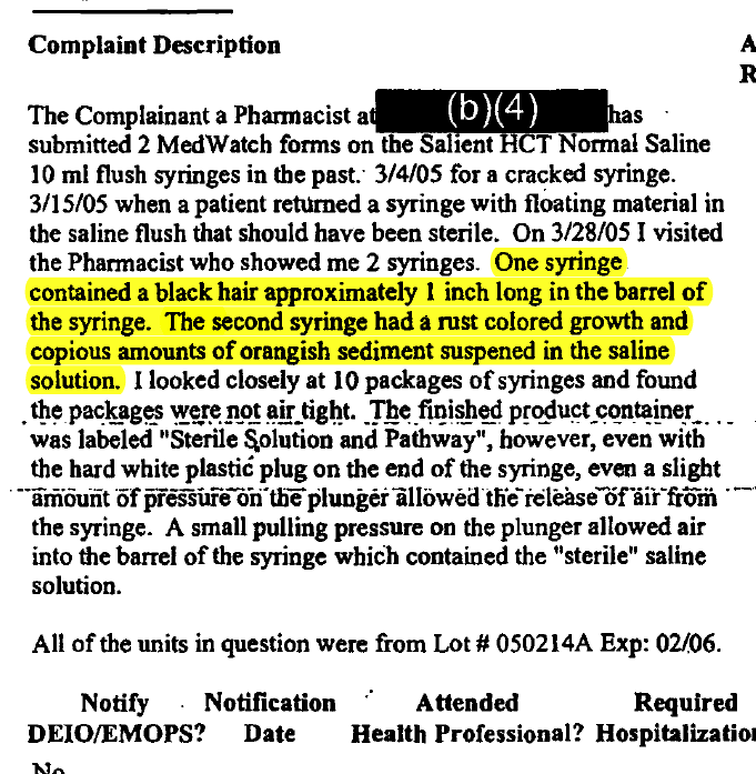 Mar. 29, 2005: A pharmacist reports 'copious amounts' of orange sediment and a hair in AM2PAT syringes.