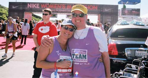 Kyle Pacheco hugs his mother after she finishes a leukemia-benefit marathon in October 2007. Pacheco, a lukemia survivor, had been cancer-free for 20 months.