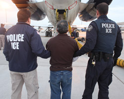 Pedro Pimentel Rios is transferred to a plane bound for Guatemala by U.S. Immigration and Customs Enforcement officials at Phoenix Mesa Gateway airport in Arizona on July 12, 2011. (U.S. Immigration and Customs Enforcement)