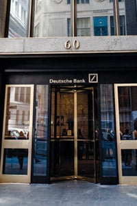 A guard stands outside the New York headquarters of Deutsche Bank in Lower Manhattan on April 8, 2010. An internal investment fund within Deutsche Bank bought the risky equity along with Magnetar in the hedge fund's maiden CDO. (Dan Nguyen/ProPublica)