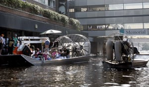 An airboat pulls up to the Memorial Medical Center in New Orleans on Aug. 31, 2005. (Bill Haber/AP Photo)