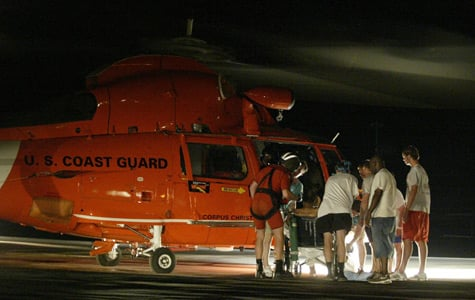 Staff members prepare the last patient to be evacuated from Memorial Medical Center in New Orleans on Sept. 1, 2005. (Brad Loper/Dallas Morning News/Corbis)