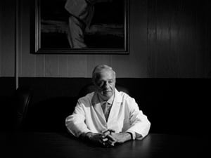 Dr. Frank Minyard in his office in New Orleans. He struggled with mixed feelings while leading an investigation into the deaths at Memorial. (Paolo Pellegrin/Magnum Photos)