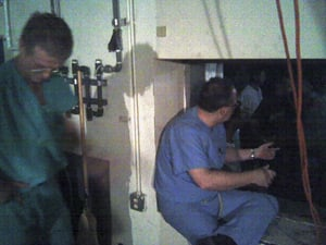 Doctors wait to pass patients through the machine-room hatch into the parking garage on their way to the helipad. (Photo Courtesy of Dr. Paul Primeaux)