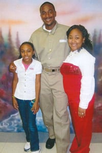 Aaron stands with his two nieces, Megan Aaron, 10, and Soporia Aaron, 19, in a family photo taken on July 25, 2010. (Photo courtesy of the Aaron family)