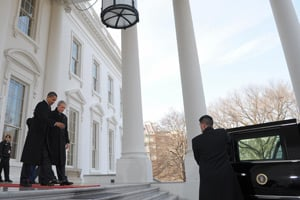 Then-President-elect Obama and President Bush leave the White House for the limousine ride to the Capitol for Obama's inauguration on Jan. 20, 2009. (Mandel Ngan/AFP/Getty Images)